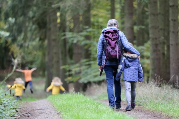 Woman and child walking through woodland